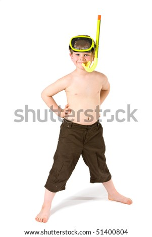 Young boy standing with arms on hips, wearing yellow mask and snorkel, smiling. Isolated on white.