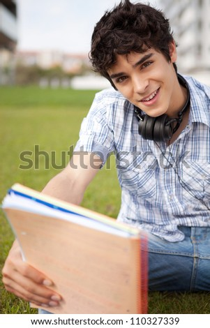 Young boy studying at the park