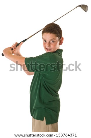 Young boy swinging a golf club