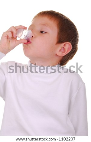 Young Boy Taking his medicine