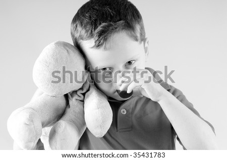Young boy taking medicine while sick