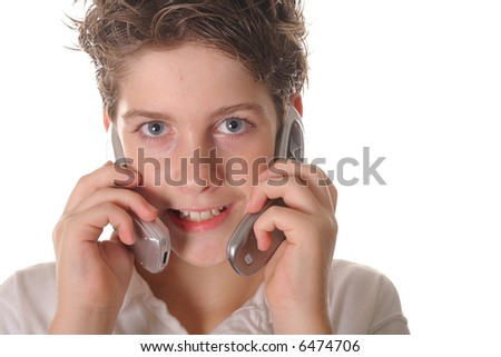 young boy talking on two cell phones