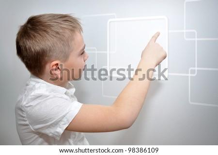 Young boy touching virtual frame