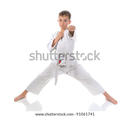 Young boy training karate. Isolated on white background