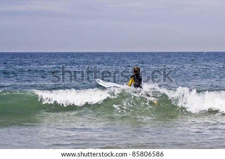 Young boy waiting the best wave for surf