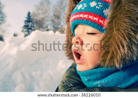 Young boy want to sneeze outdoor.