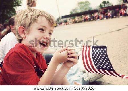 Young boy watching Holiday parade
