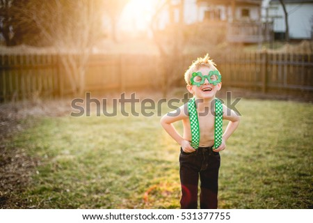 Young boy wearing St. Patrick's day wear.