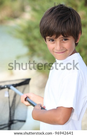 Young boy with a fishing net - stock photo