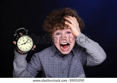 Young boy with alarm clock