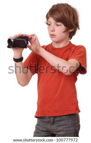 Young boy with camcorder on white background
