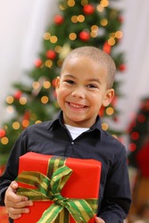 Young boy with Christmas gift