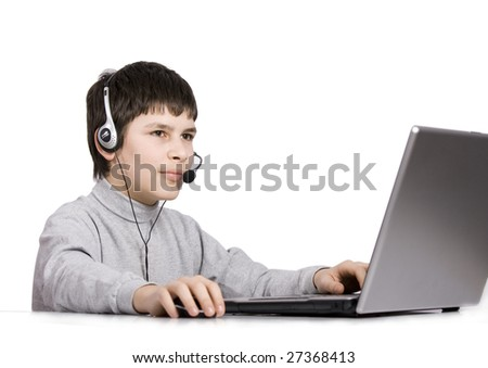 Young boy with computer thinking isolated on white