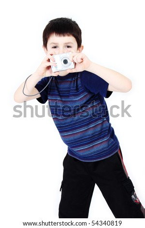 Young boy with digital camera prepare for shooting
