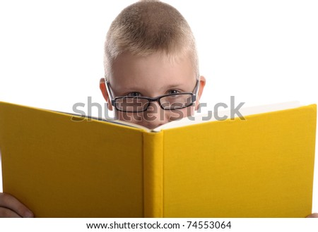 young boy with glasses reading a book, Isolated on white background