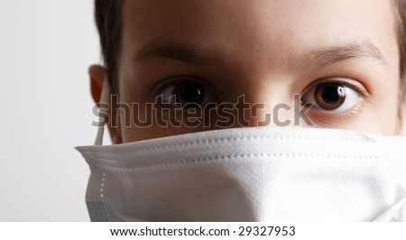 young boy with health mask for is protection again virus. White background