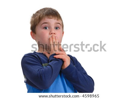 """Young boy with his hand on his mouth, signifying """"Speak No Evil"""",  isolated on white with copy space"""