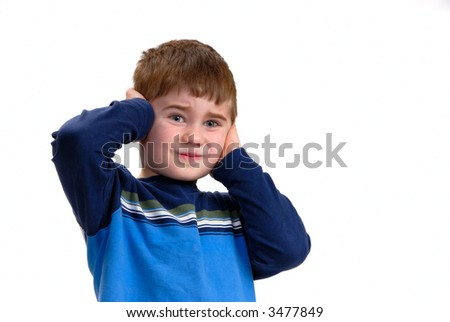 Young boy with his hands on his ears, isolated on white