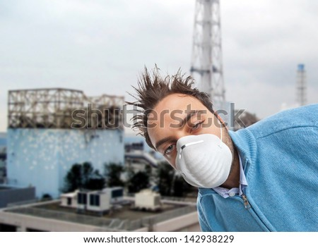 Young boy with mask respiratory protection near nuclear reactors