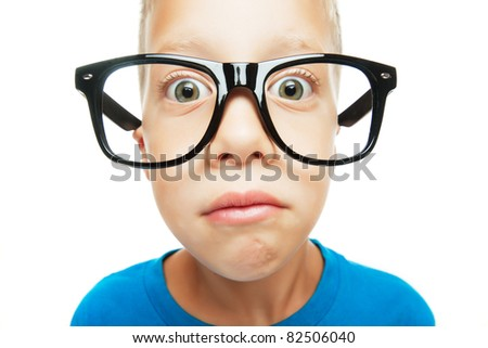Young boy with nerd glasses isolated on white background