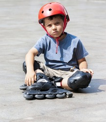 Young boy with rollerblades stopping to tighten up