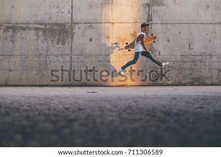 Young boy with skate and cap