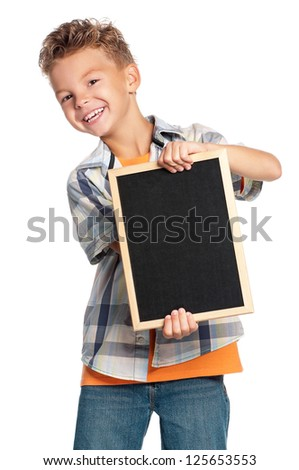 Young boy with small blackboard, isolated on white background