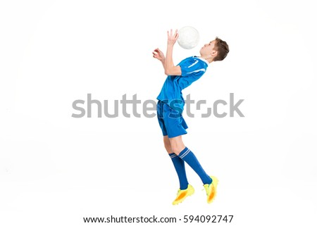 young boy with soccer ball...