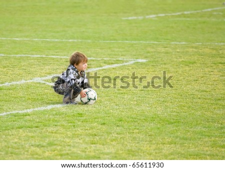 Young boy with Soccer ball/football on field