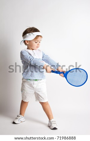 Young boy with tennis racket