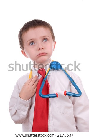young boy with white shirt, stethescope and red tie looking like a doctor