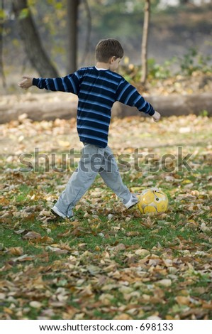 Young boy with yellow ball in the park