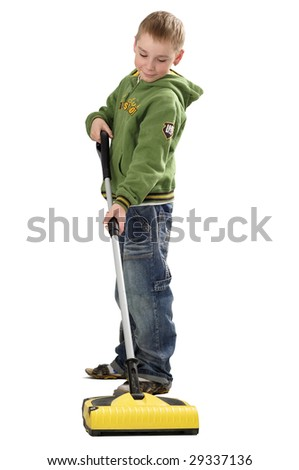 young boy (8-10 years) cleaning the floor with vacuum cleaner, isolated on white