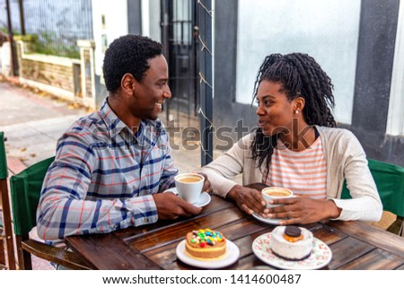 Young boyfriends look and talk at the coffe bakery shop. #1414600487