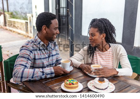 Young boyfriends look and talk at the coffe bakery shop. #1414600490
