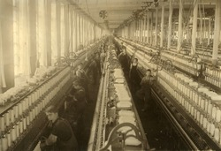 Young boys and girls working in the spinning room of the Cornell Mill in Fall River, Massachusetts. January 1912 photo by Lewis Hine.