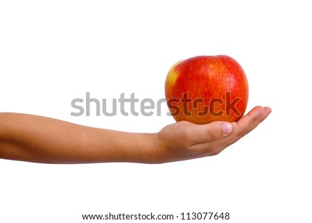 Young boys arm extended holding an red apple ready to give to somebody. Arm and hand isolated on white.