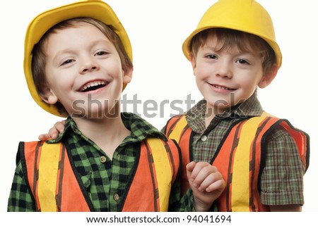 young boys, construction workers  in a hard hat , on a white background