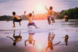 young boys jumping into the lake.