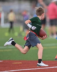 Young boys playing in a flag football game
