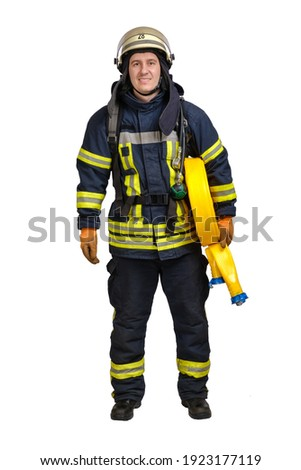Young brave man in uniform and hardhat of firefighter holds fire hose in hand and looking at camera isolated on white background