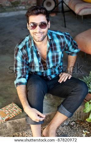 Young Brazilian man wearing sunglasses