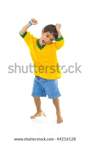 Young Brazilian supporter celebrating a score .