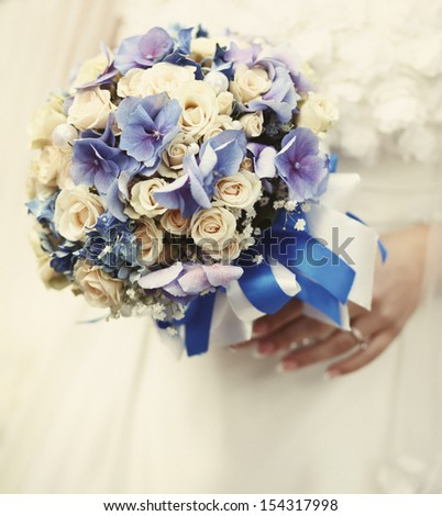 young bride holding a wedding bouquet