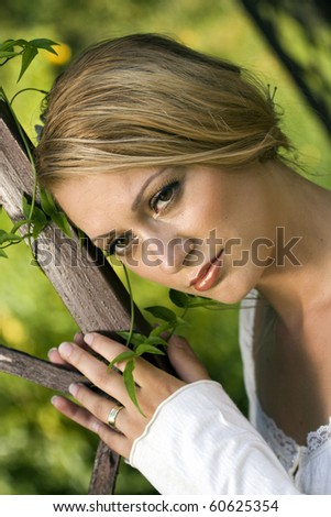 Young bride with her wedding ring, day dreaming.