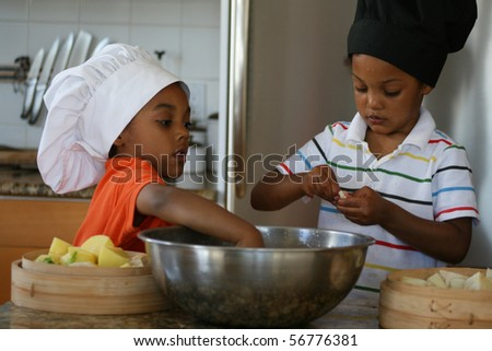 Young brothers preparing a delicious meal.