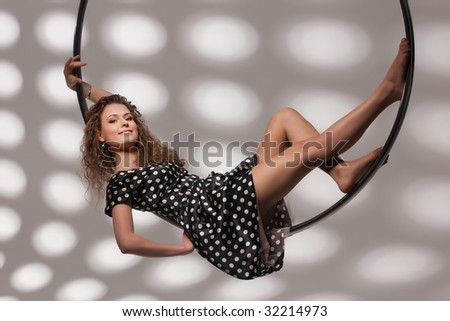Young brown-haired woman on the metal ring