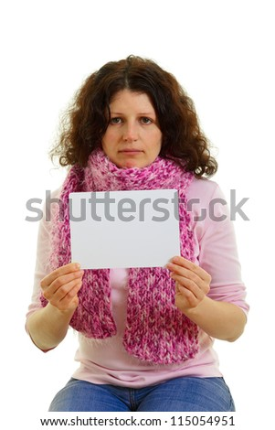 Young brown-haired woman with empty white panel isolated on white background, studio shot.