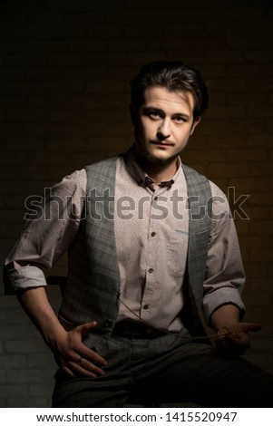 Young brunett in shirt and vest with pocket watch #1415520947