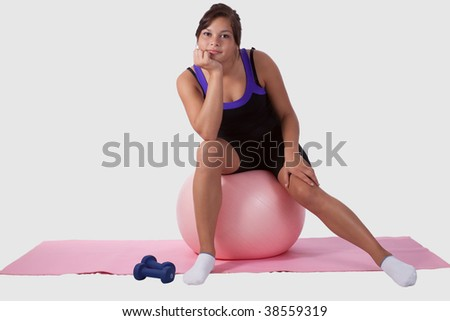 stock photo : Young brunette aboriginal teen girl wearing workout attire ...